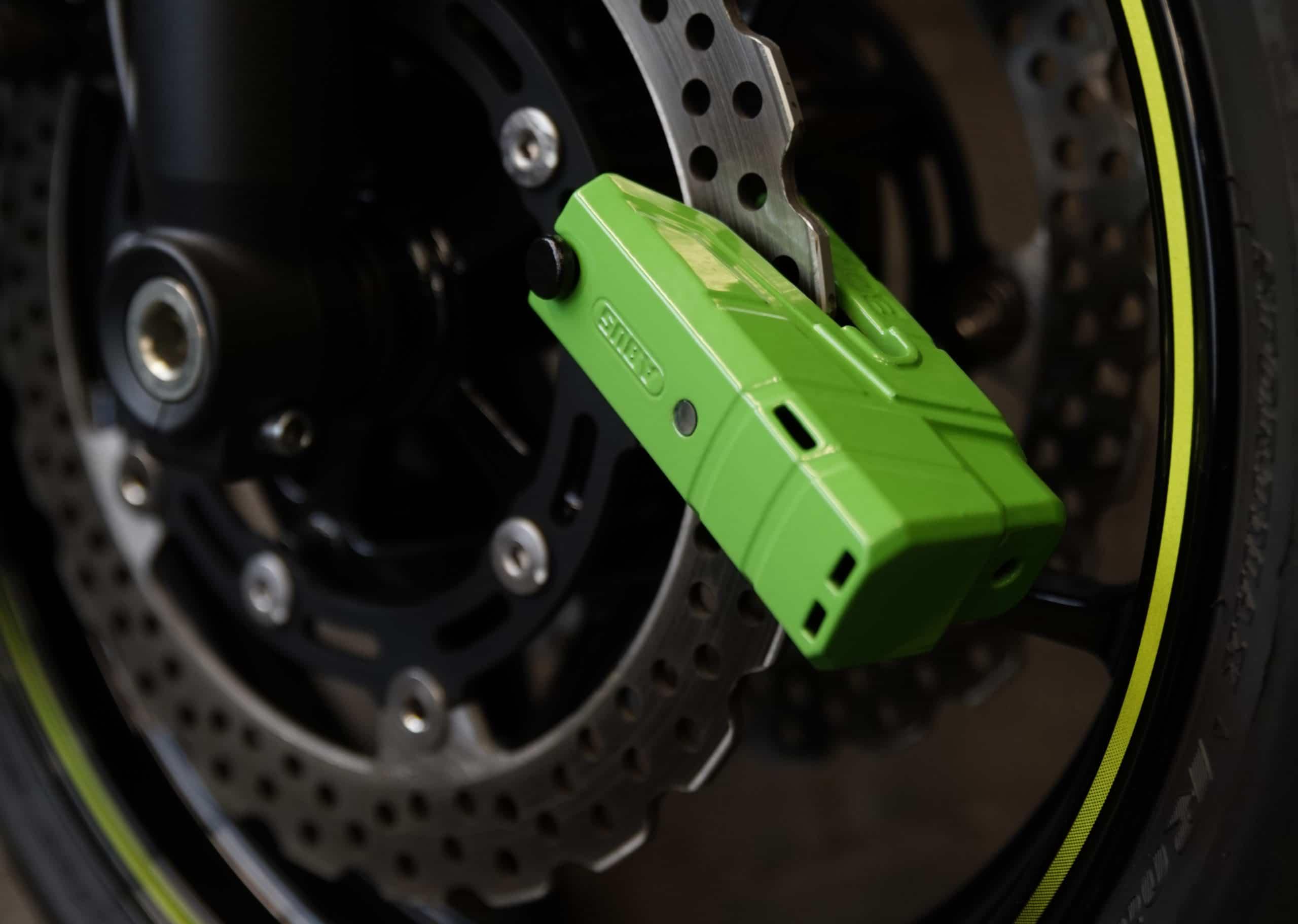 Abus Motorrad Bremsscheibenschloss in grün mit Alarm